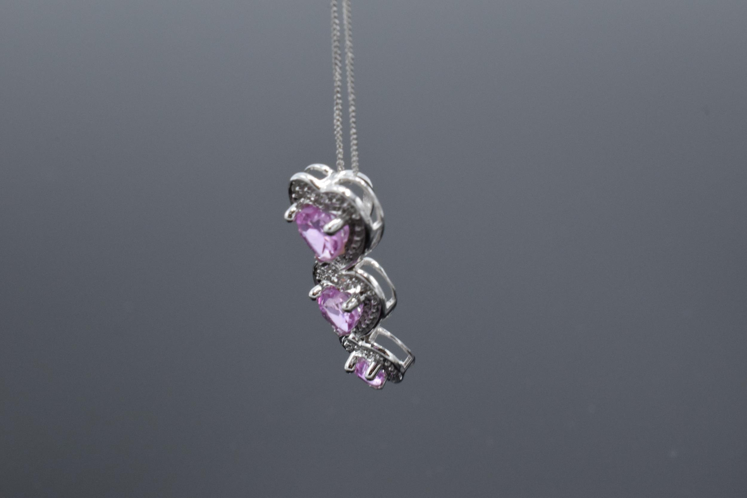 A 10ct white gold triple-heart pendant set with pink topaz and 3 diamonds on a 9ct white gold chain. - Image 3 of 5