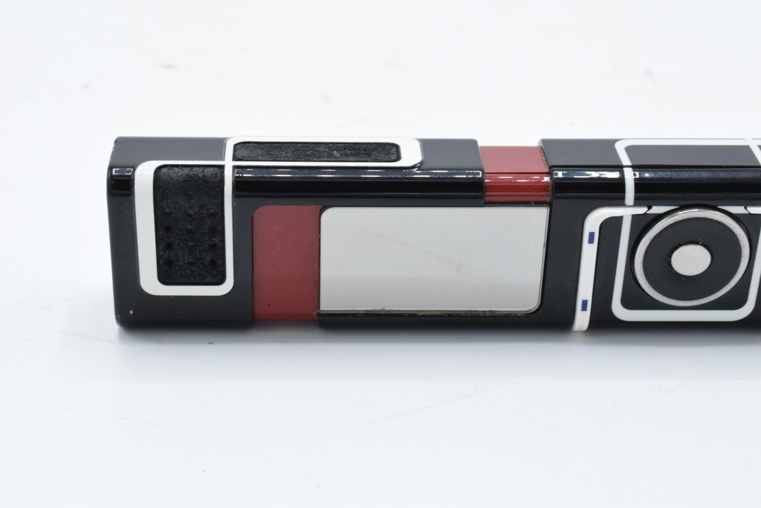 Nokia 7280 'lipstick' mobile phone complete with charger, ear phones and a printed user guide. - Image 3 of 8