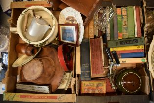 A mixed collection of items to include an enamel candlestick, leather hat, early 20th century