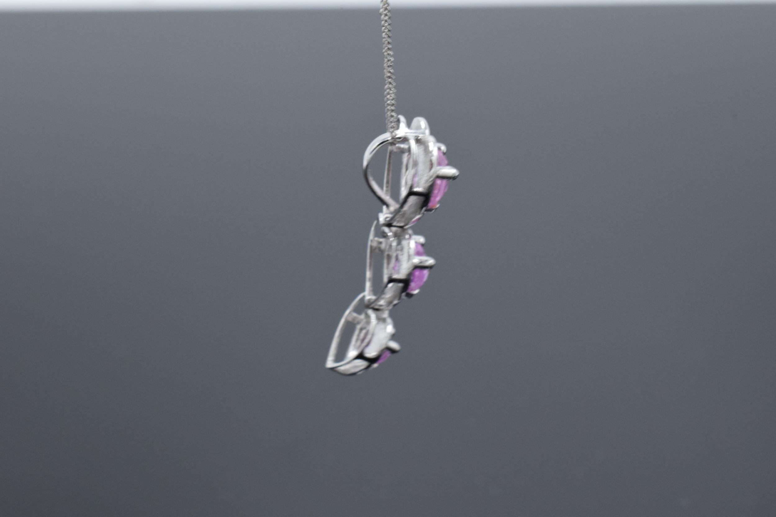 A 10ct white gold triple-heart pendant set with pink topaz and 3 diamonds on a 9ct white gold chain. - Image 2 of 5