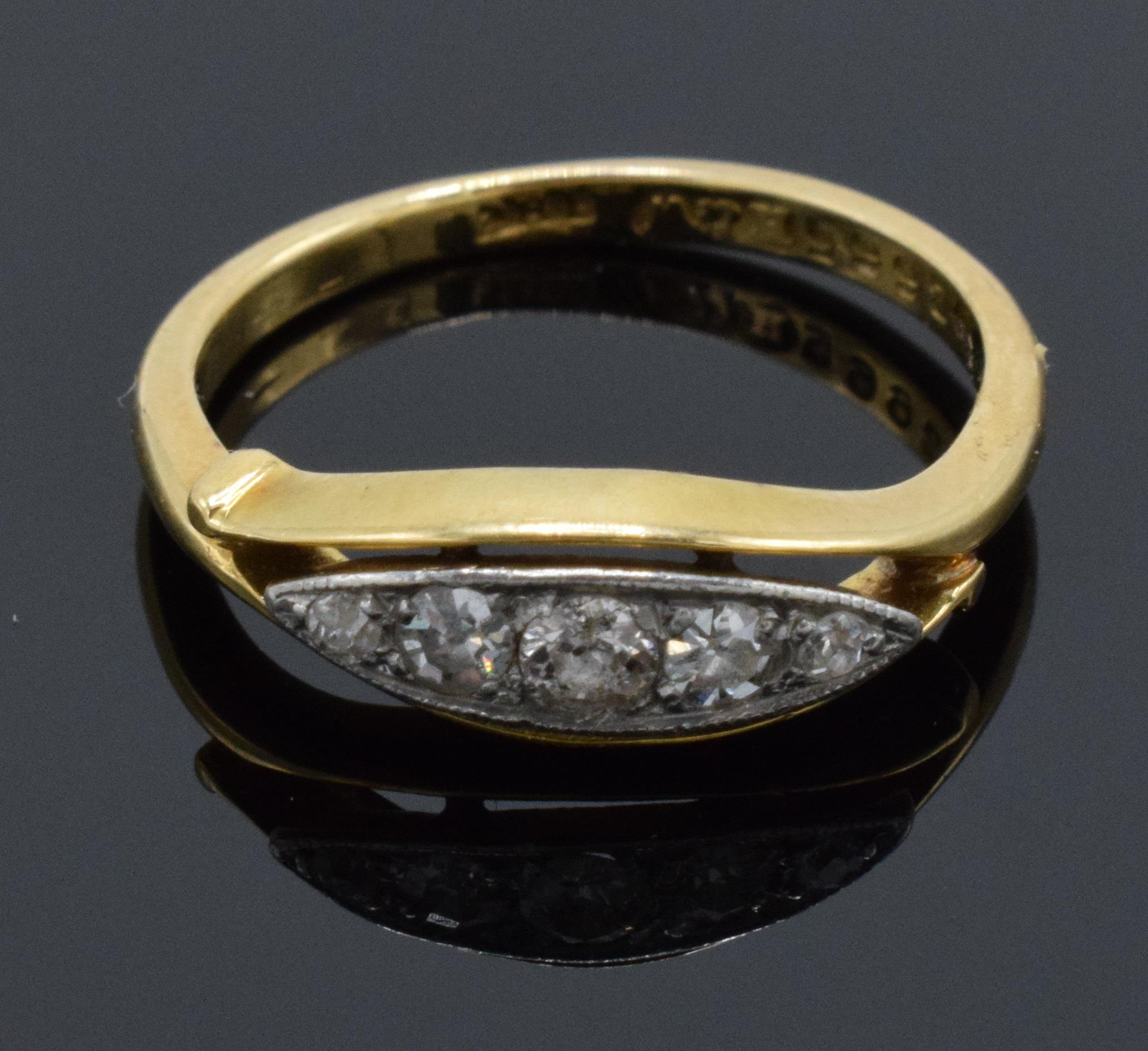 18ct gold ring set with 5 diamonds. UK size K/L. 2.7 grams. In good condition.