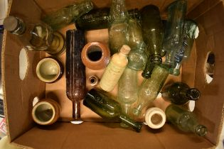 A mixed collection of vintage items to include stoneware jars and advertising glass bottles to