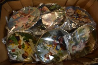 A large collection of Franklin mint and similar wall plates with designs such as children scenes,