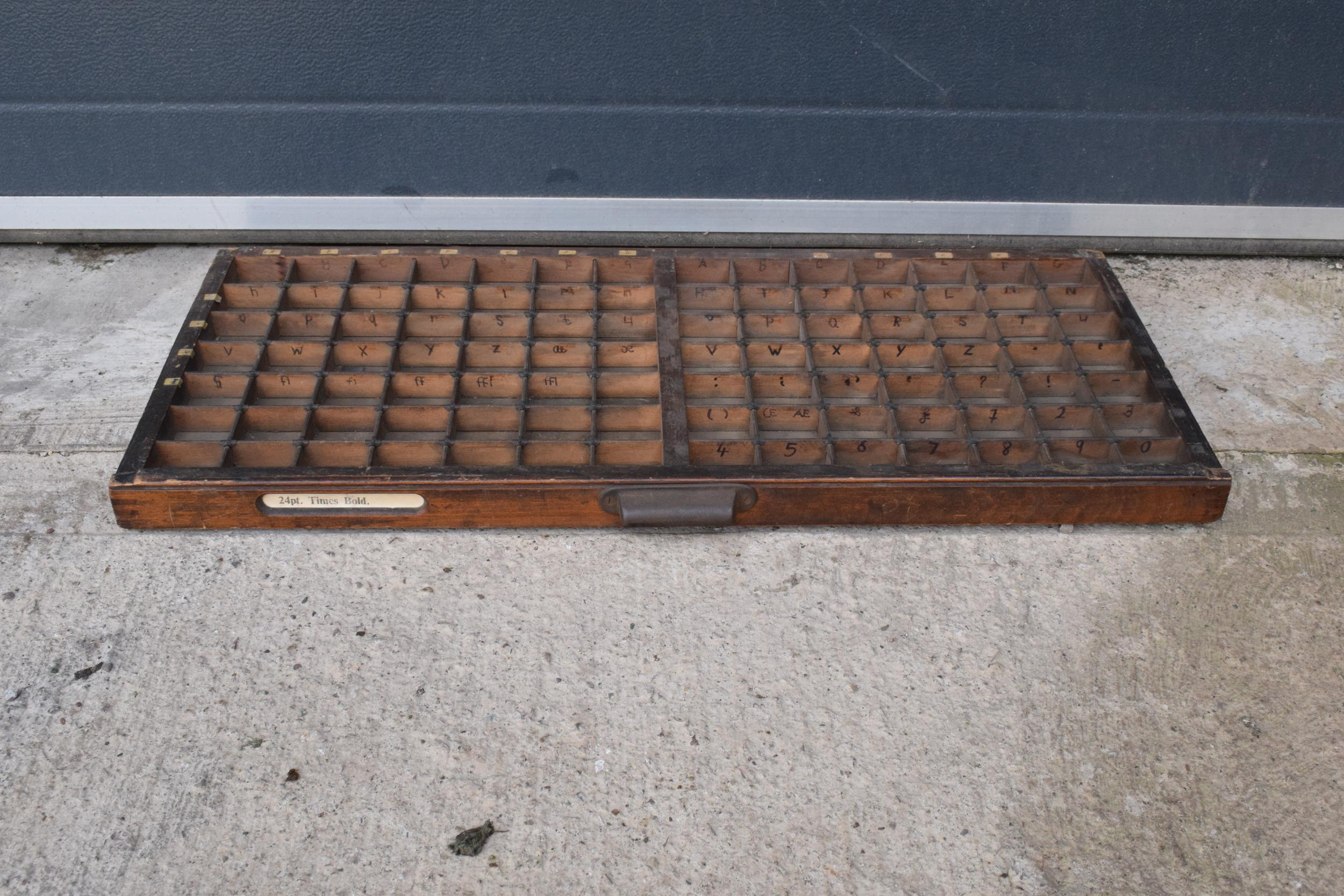 An early 20th century wooden printers letter block tray / rack with brass tacts. 83 x 39cm, (1271).