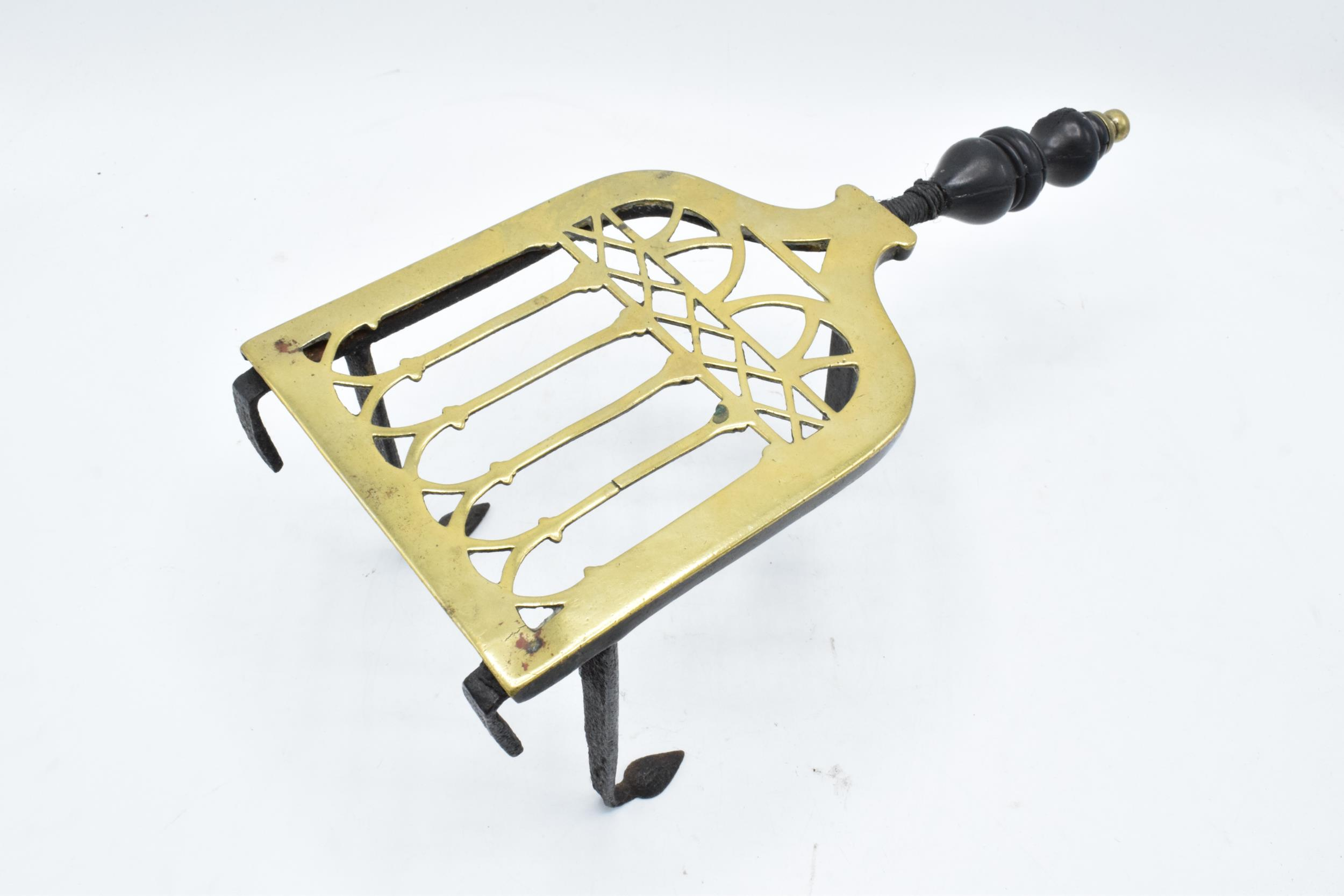 Victorian brass and iron trivet with wooden handle (some chipping to wood). - Image 2 of 6
