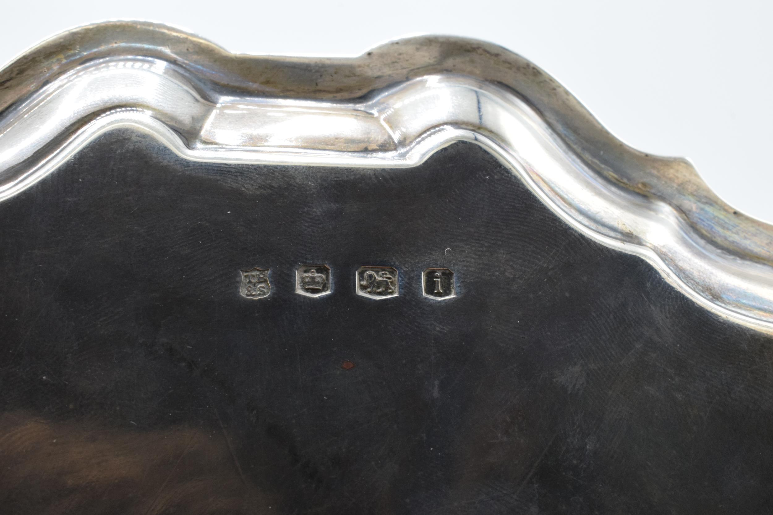 A hallmarked silver salver with shaped edge raised on three feet. Hallmarked for Sheffield 1926. - Image 6 of 6