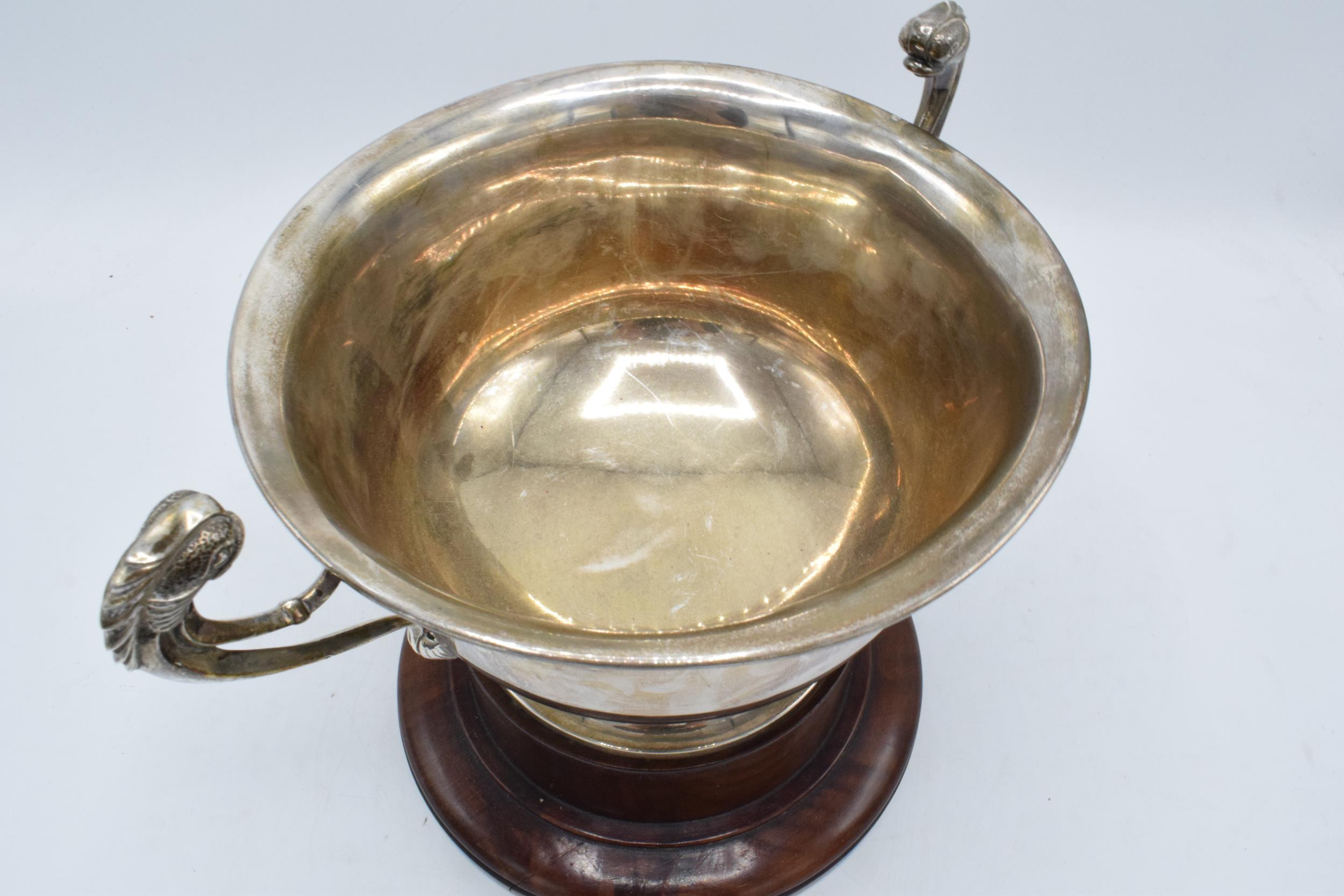 A large silver pedestal bowl raised on a turned wooden plinth with ornate handles. Circa 700 - Image 10 of 10