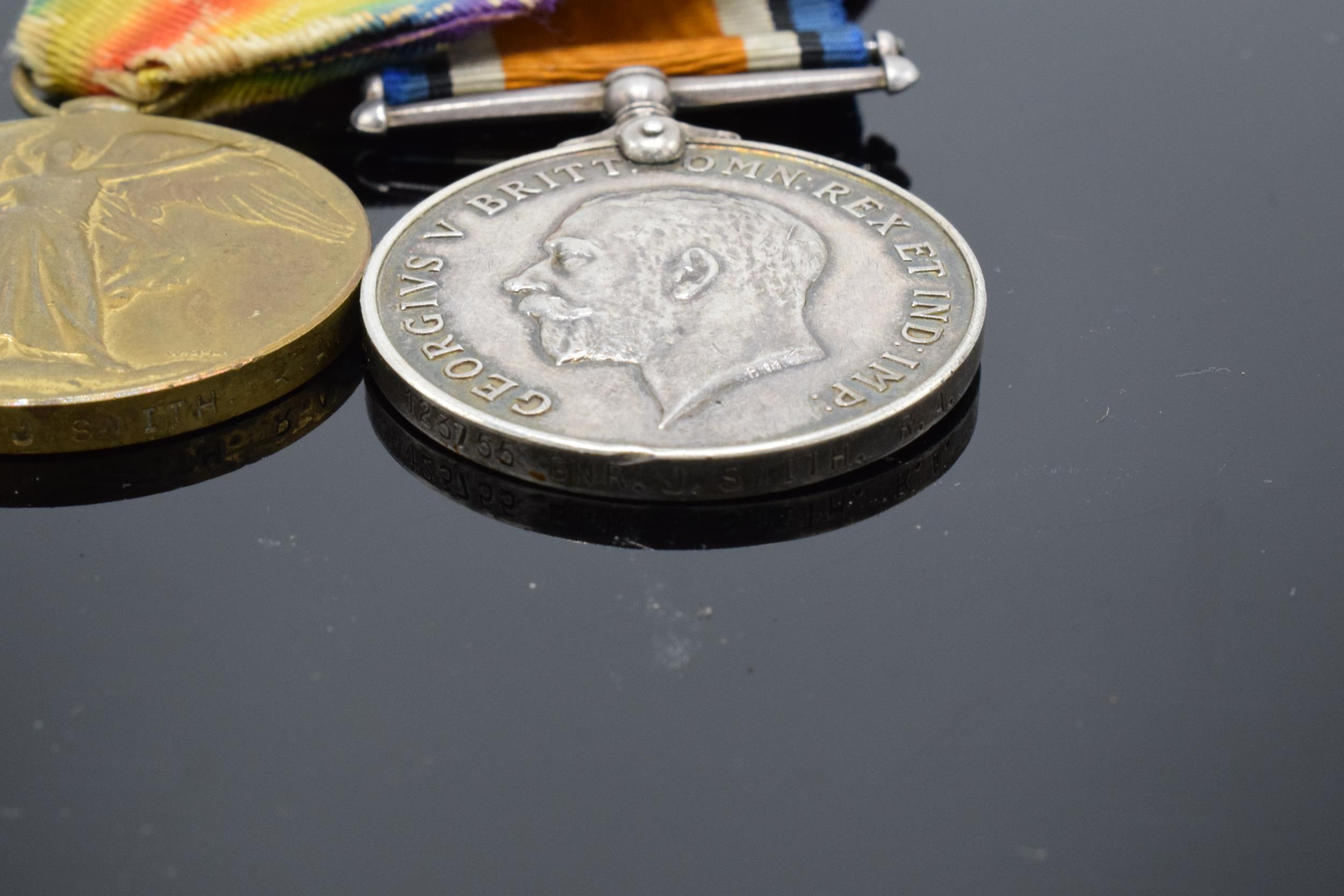 A pair of World War One (WW1) medals awarded to '123755 GNR J. Smith R.A.' to include George V - Image 3 of 6