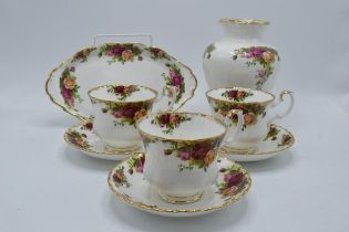 A collection of Royal Albert items in the Old Country Roses design to include 3 breakfast cups and