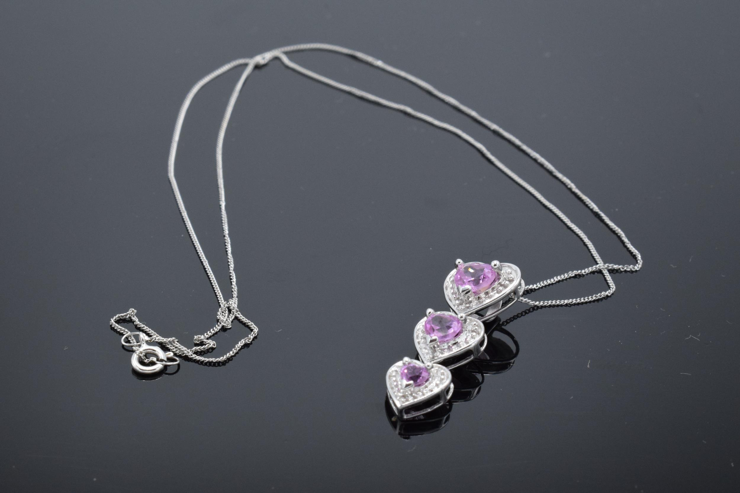 A 10ct white gold triple-heart pendant set with pink topaz and 3 diamonds on a 9ct white gold chain. - Image 5 of 5