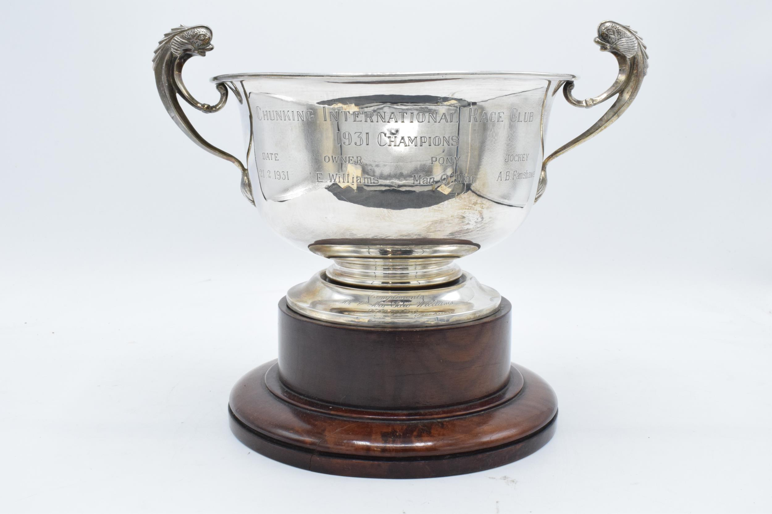 A large silver pedestal bowl raised on a turned wooden plinth with ornate handles. Circa 700 - Image 2 of 10