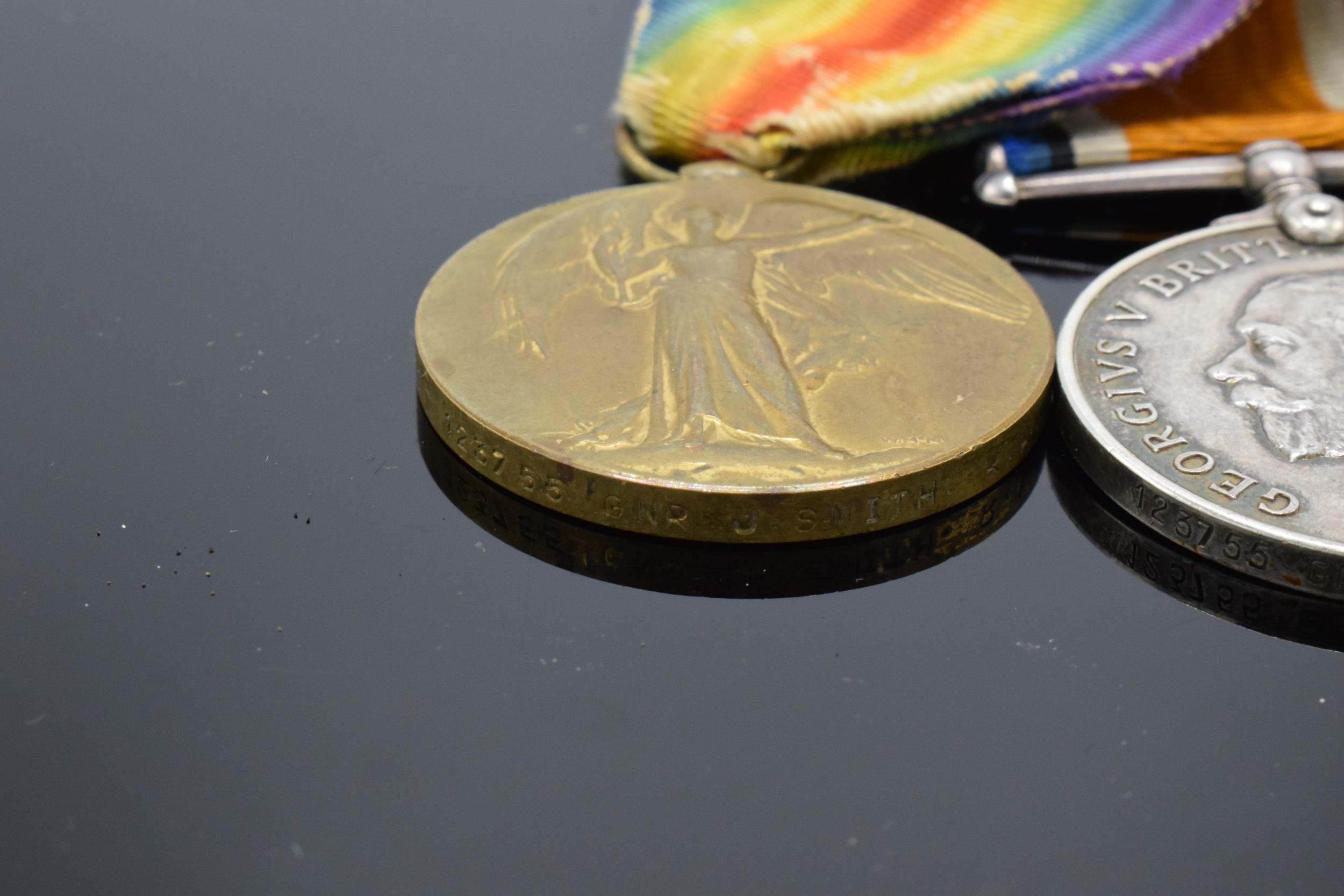 A pair of World War One (WW1) medals awarded to '123755 GNR J. Smith R.A.' to include George V - Image 4 of 6