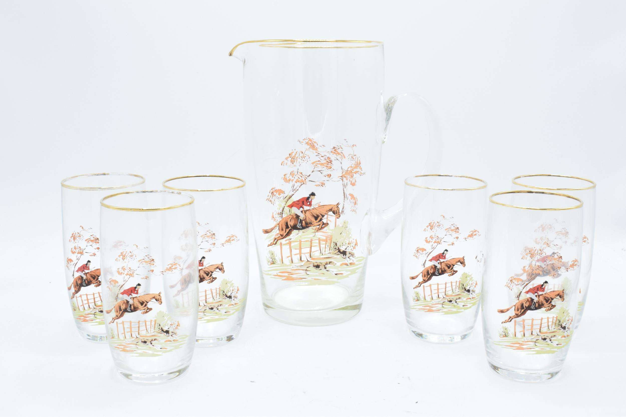 A glass water jug together with 6 glasses depicting traditional hunting scenes (7). In good - Image 2 of 5