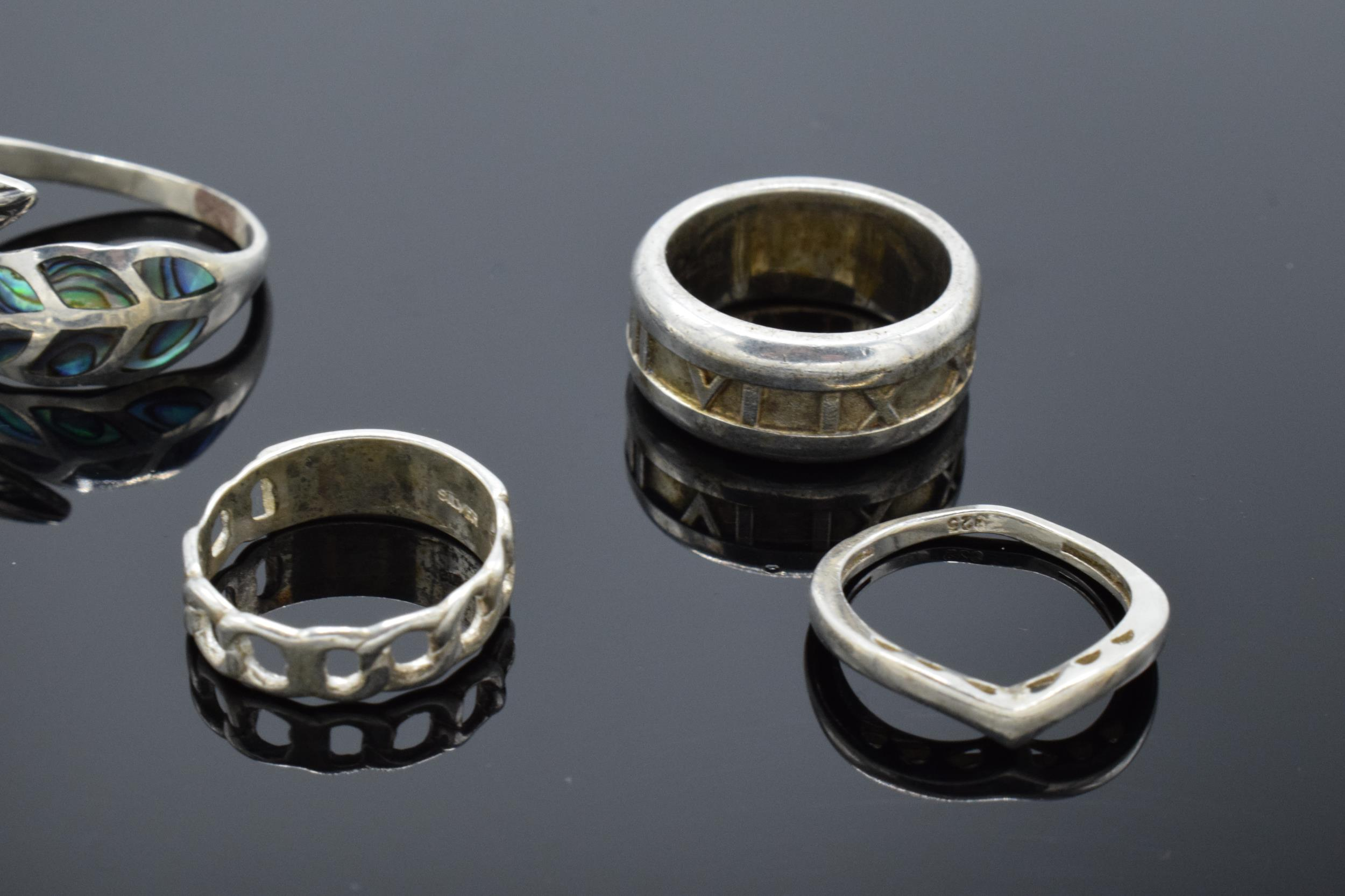 A collection of silver 925 rings to consist of various sizes and designs, some are set with semi- - Image 2 of 3