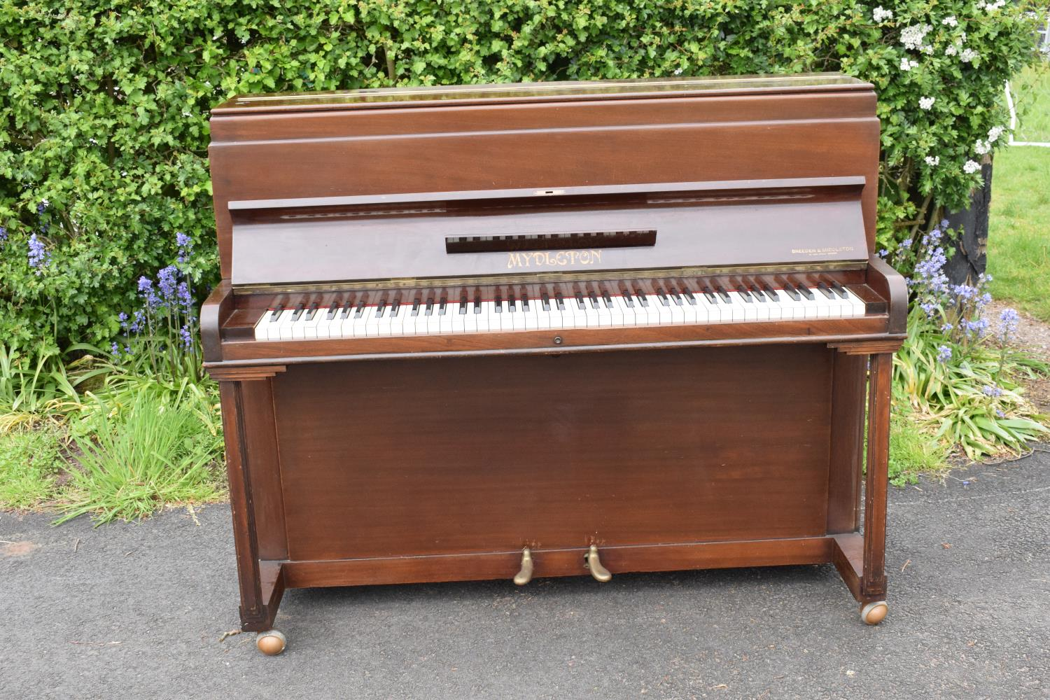 A Breedon and Middleton 'Mydleton' of 42 High Street Crewe upright wooden piano with 85 keys