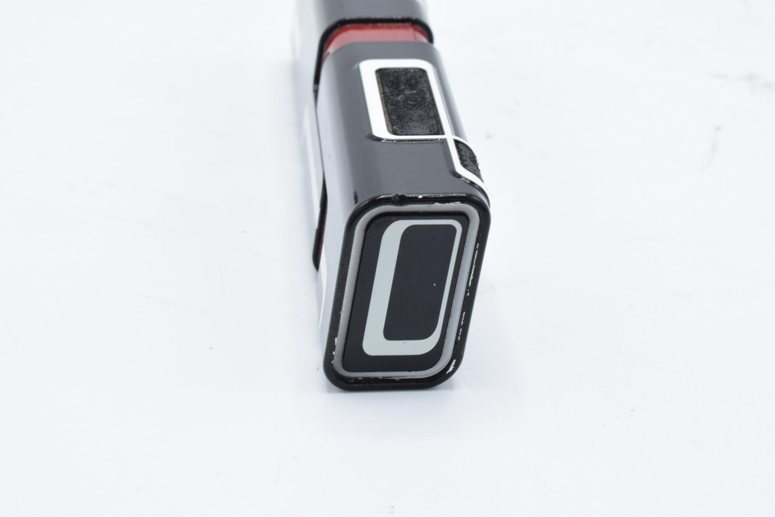 Nokia 7280 'lipstick' mobile phone complete with charger, ear phones and a printed user guide. - Image 7 of 8