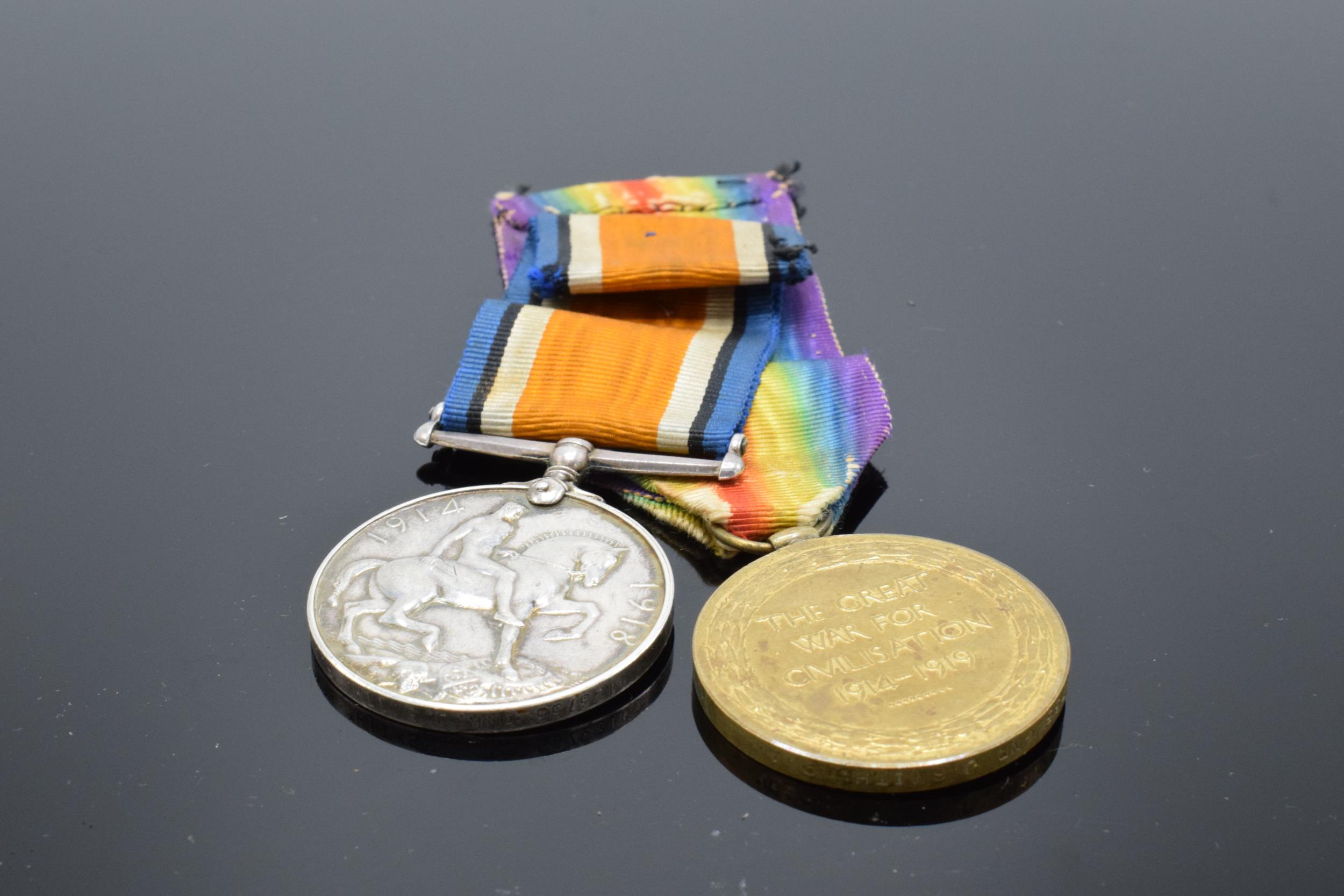 A pair of World War One (WW1) medals awarded to '123755 GNR J. Smith R.A.' to include George V - Image 6 of 6
