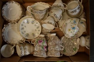 A collection of items to include 2 tea sets to include trios, milk and sugars, cake plates plus