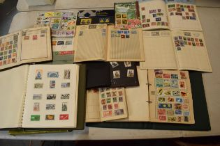 A mixed collection of assorted stamp albums covering UK and world countries