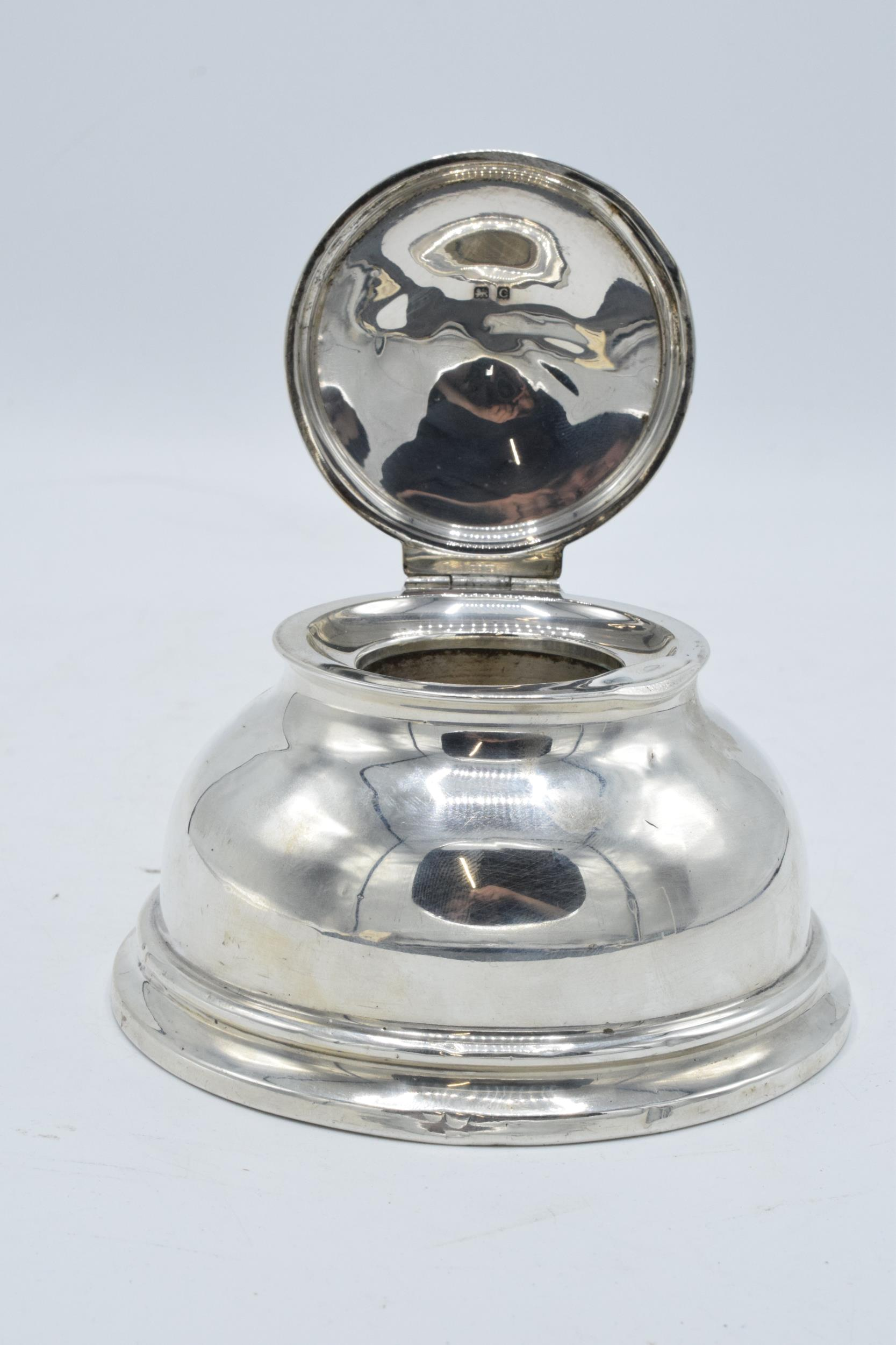 Large hallmarked silver inkwell with hinged lid. Birmingham 1927. 12cm widest diameter. No liner.