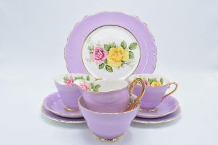 A pink and floral china tea set to consist of 6 trios, milk, sugar and a cake plate (21 pieces).