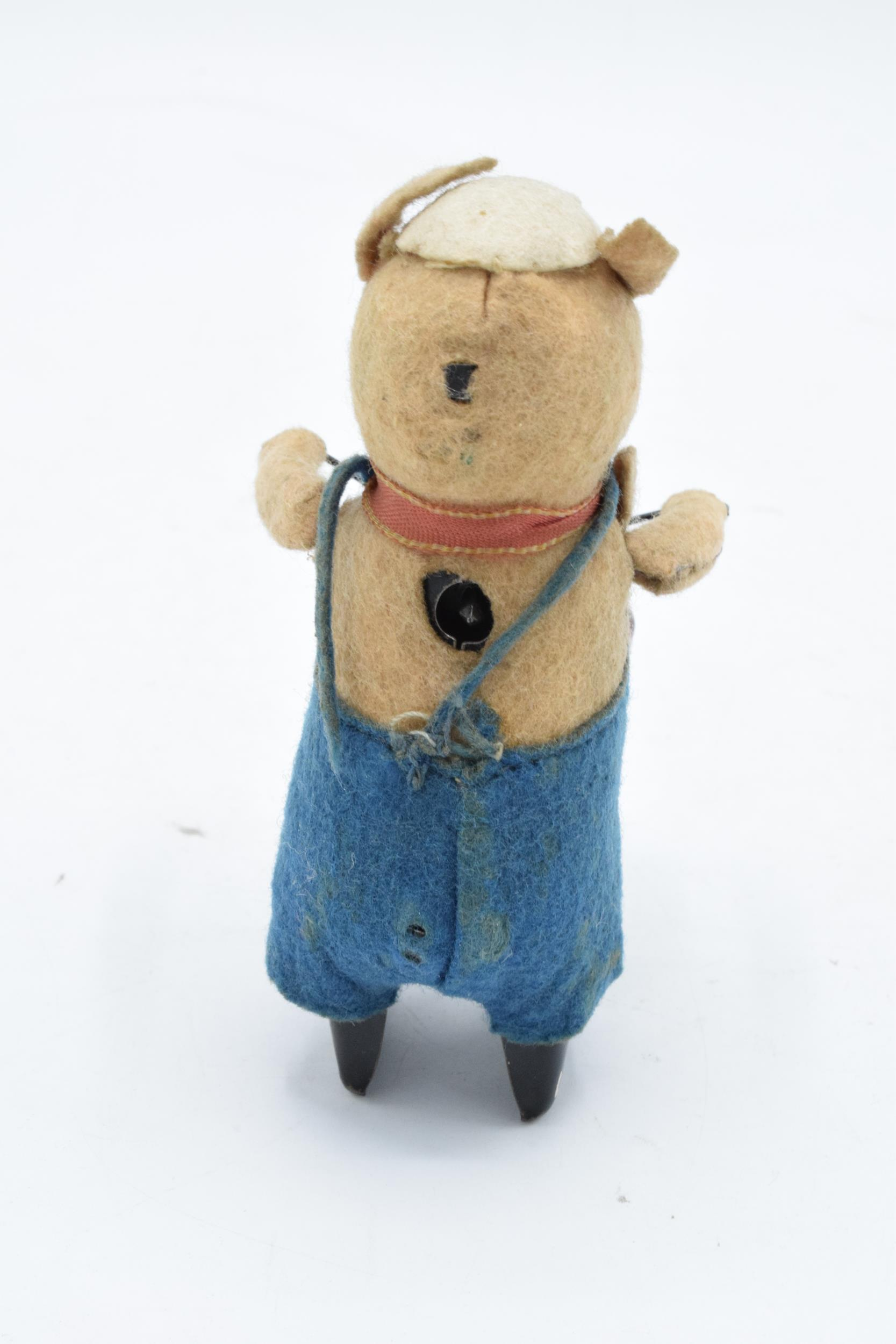 A Schuco circa 1930s clockwork toy figure in the form of a pig with a drum. Based on the Three - Image 4 of 7