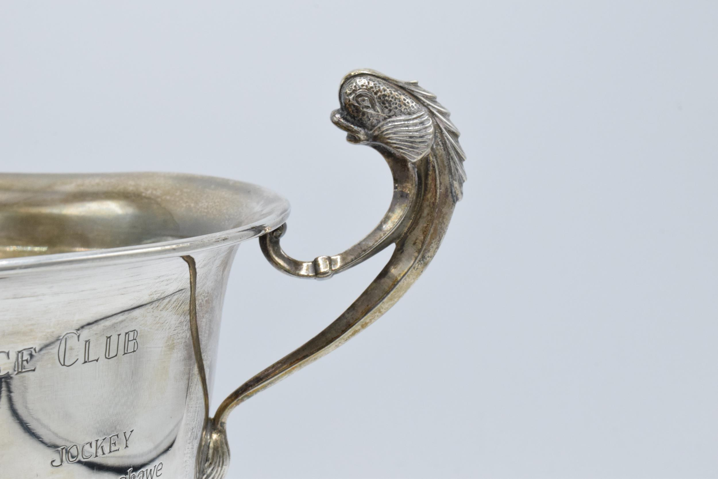A large silver pedestal bowl raised on a turned wooden plinth with ornate handles. Circa 700 - Image 6 of 10