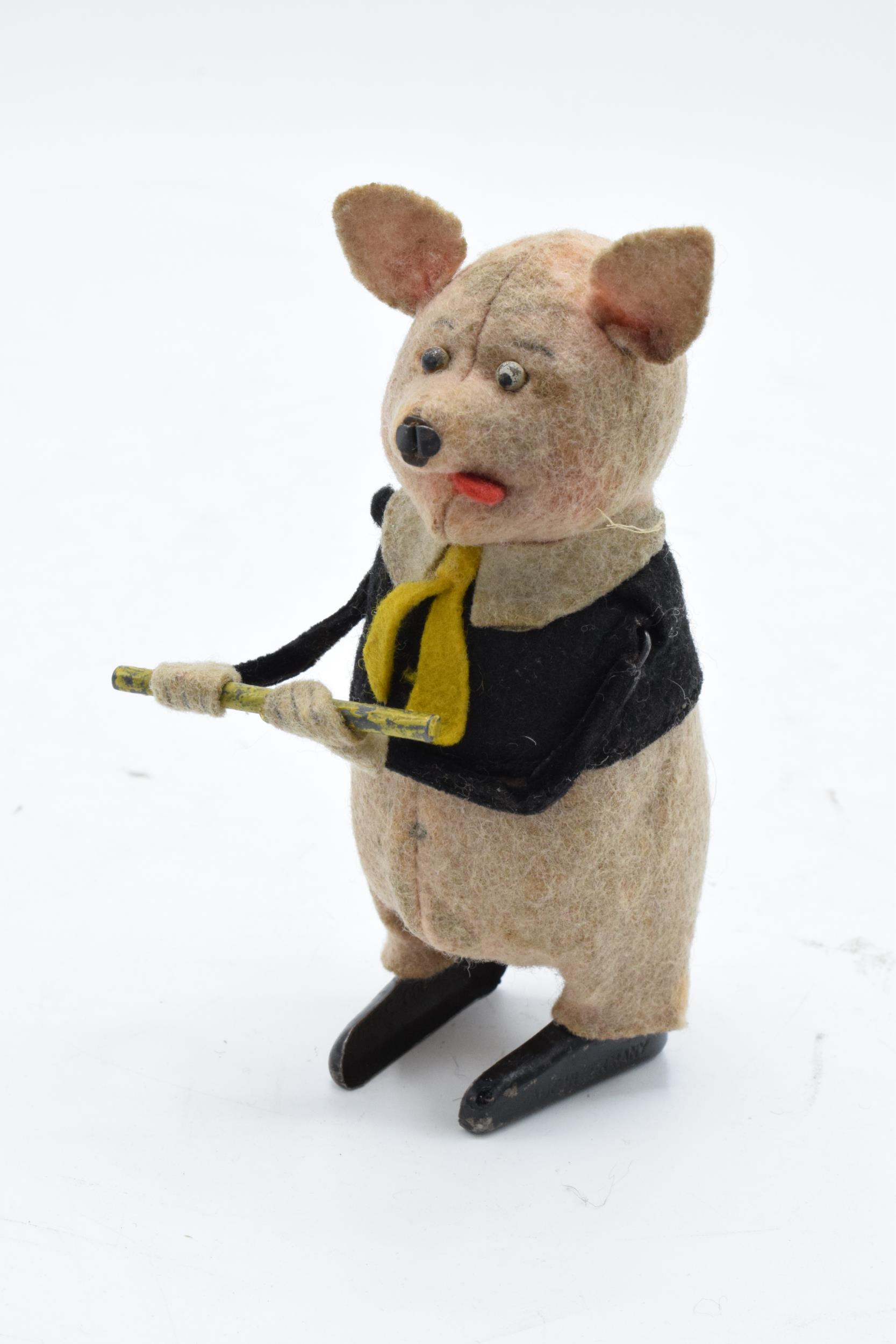 A Schuco circa 1930s clockwork toy figure in the form of a pig with a flute (with key). Based on the - Image 2 of 7