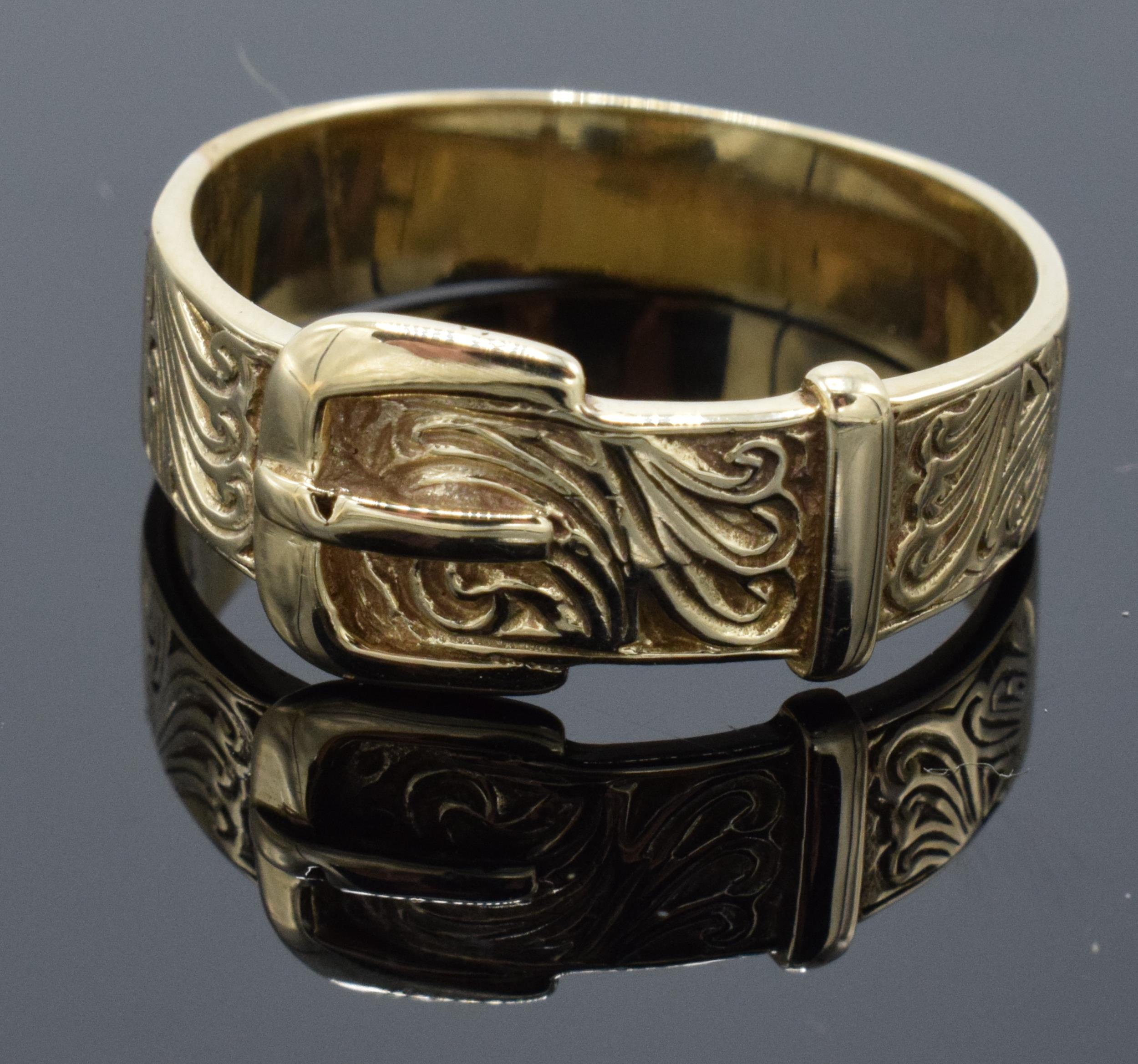 A large Gentlemans 9ct gold ring in the form of a buckle. UK size Z+2. 6.2 grams.