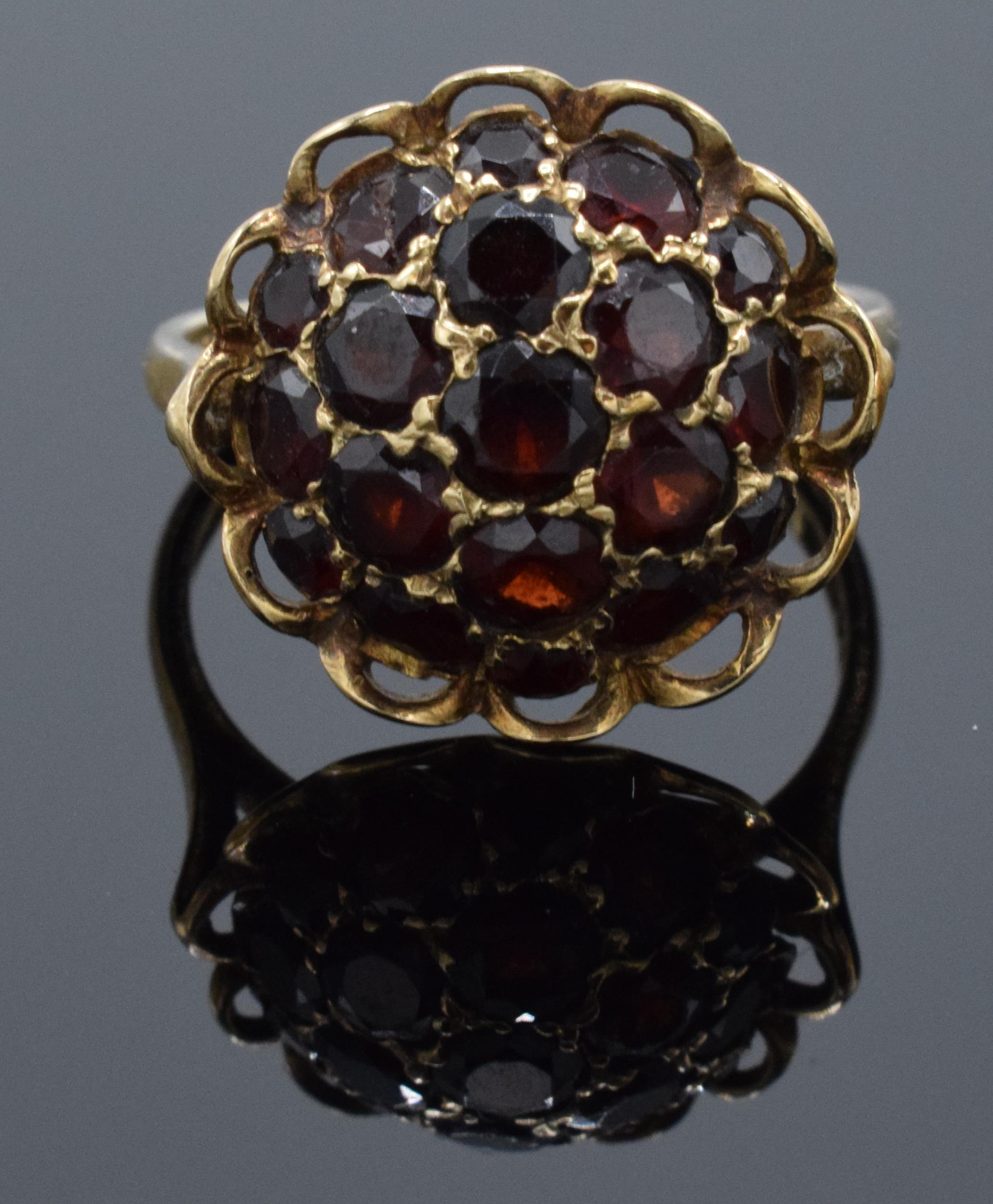 A 9ct gold dress ring set with garnet stones. 3.6 grams.