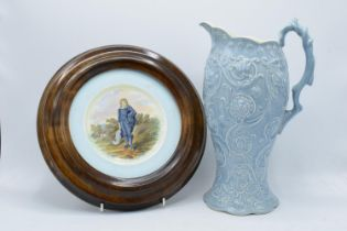 A Royal Cauldon plate of The Blue Boy by Gainsborough set in a wooden wall mount together with a