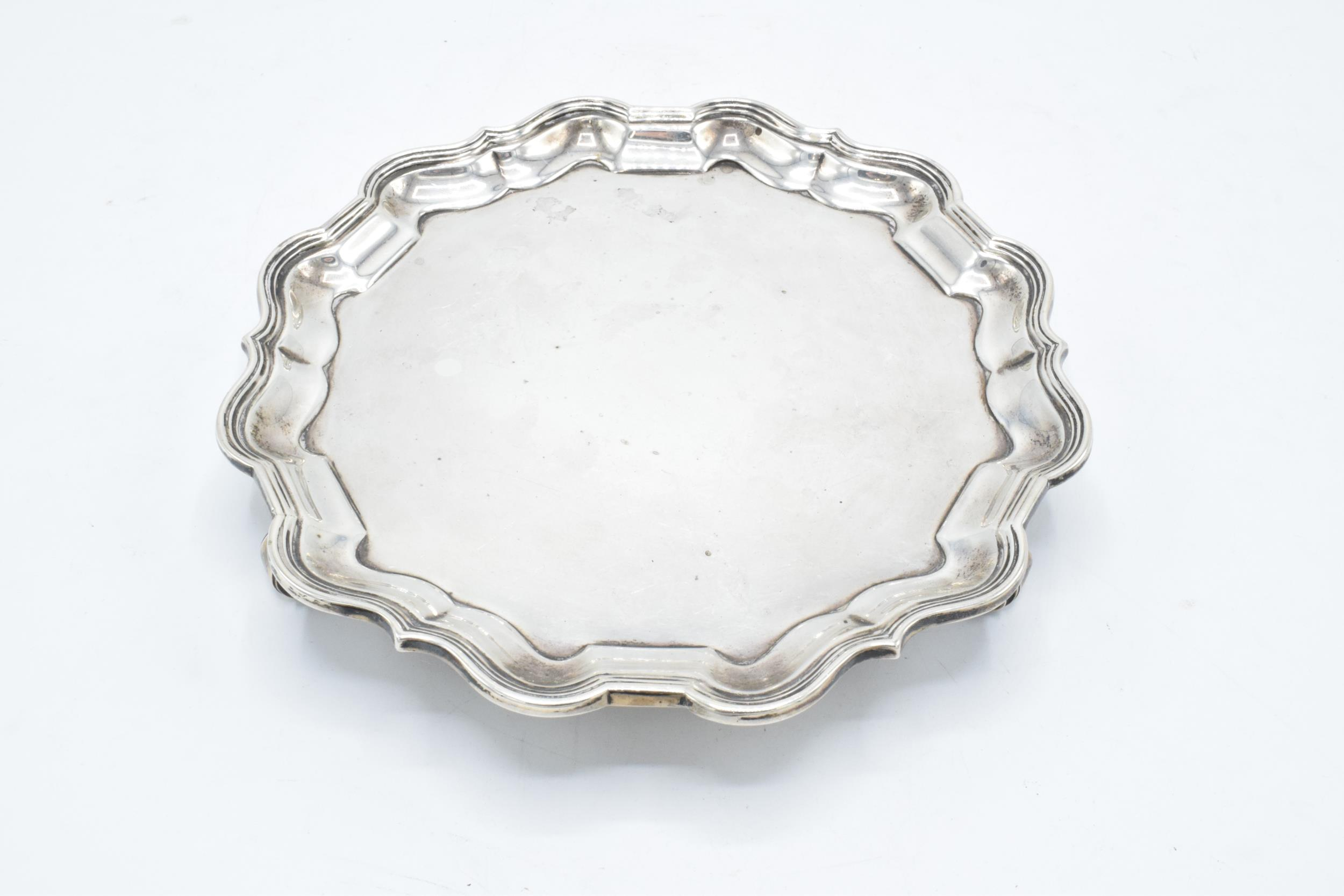 A hallmarked silver salver with shaped edge raised on three feet. Hallmarked for Sheffield 1926. - Image 2 of 6