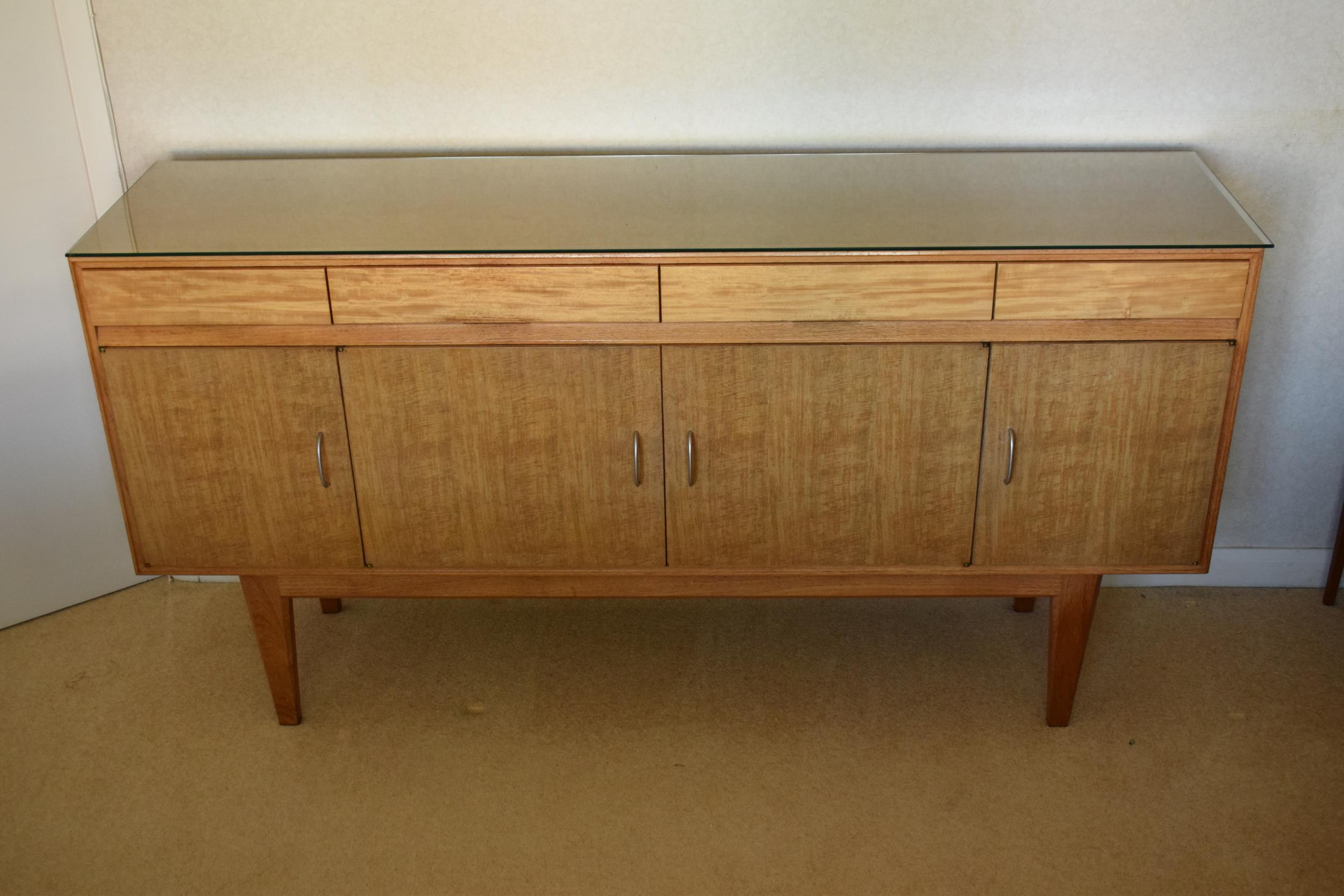 Gordon Rusell Limited four-door mid-century / retro sideboard on tapered legs with 4 drawers too.