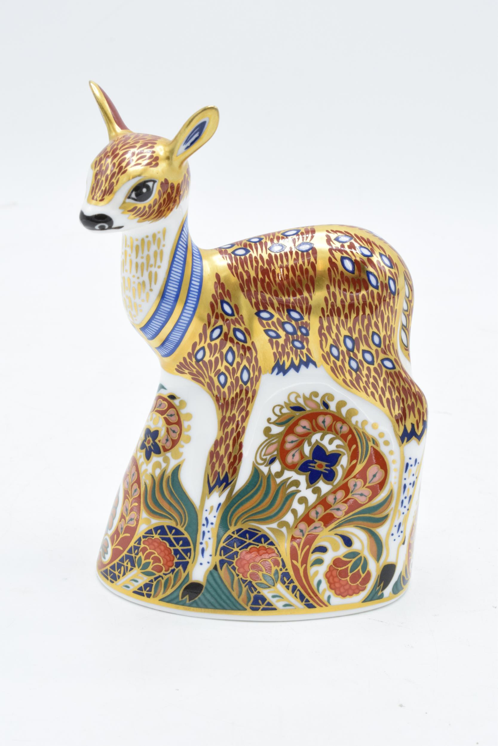 Boxed Royal Crown Derby paperweight in the form of a Fawn. First quality with stopper. In good