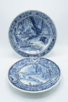 A pair of Delfts blue and white wall chargers depicting country and hunting scenes. 'Made for