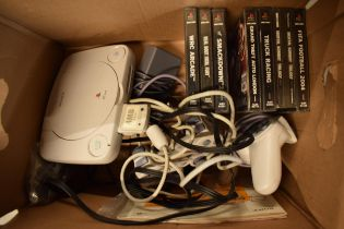 A collection of gaming interest items to include a Playstation 1, a Playstation 2 Thin, controllers,