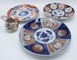 A collection of oriental pottery to include Two Japanese Imari plates, together with a modern
