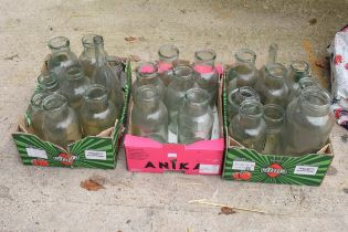 A large collection of glass items to include bottles, jars etc (approx 25) NO POSTAGE
