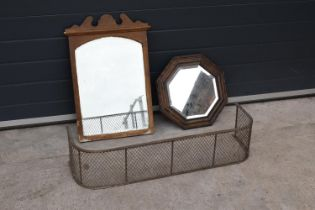 A collection of items to include a carved oak octagonal mirror, a rectangular mirror and a brass and
