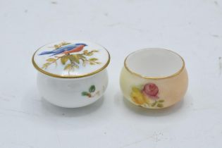 A pair of Royal Worcester miniature pots to include a floral scene and a bird amongst foliage (2).