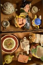 A mixed collection of pottery to include novelty teapots, character jugs, wall plates etc (no