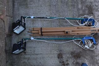 A pair of home made adjustable lighting stands which can be fixed to a table using the G clasp