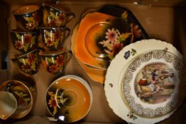 A collection of Empire Ware orange lustre tea set decorated with a floral design to include 6
