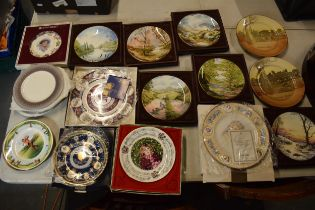 A collection of plates to include various scenes including Royal Doulton seriesware, commemorative