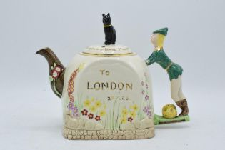 A 1940s novelty ceramic tea pot in the form of Dick Whittington and his cat by Bancroft and