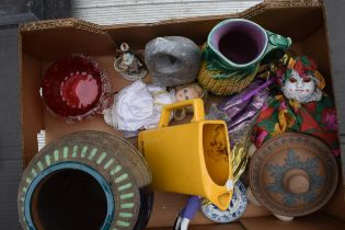 A mixed collection of pottery to include vases, a pub jug, majollica jug, cranberry glass etc (