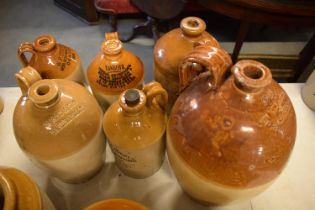 A collection of stoneware jars and flagons to include R Ross of Barbraville, Davies Haynes and