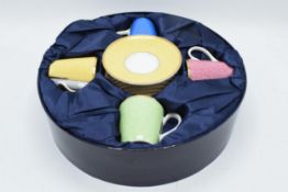 A cased Royal Worcester set of 4 cups and saucers in different colours in Celebration of HRH 80th