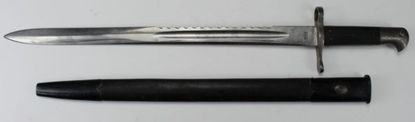 German WW1 saw back bayonet with scabbard, blade maker marked 'P.D.L.' Scabbard and handle