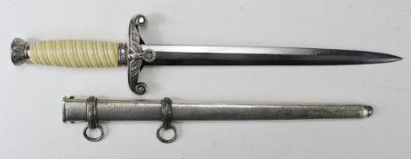 German Nazi Army Dagger, with scabbard, blade maker marked 'WKC Solingen'.